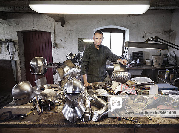 Blacksmith with armor in shop