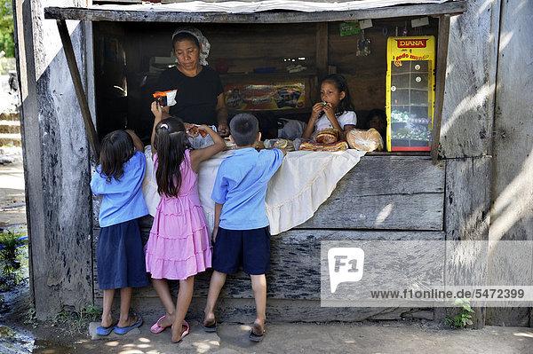 Children buying sweets at a stall during a break  school in Las Mesitas  Bajo Lempa  El Salvador  Central America  Latin America