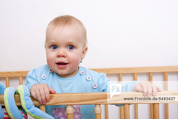 Baby  1 year  in a cot