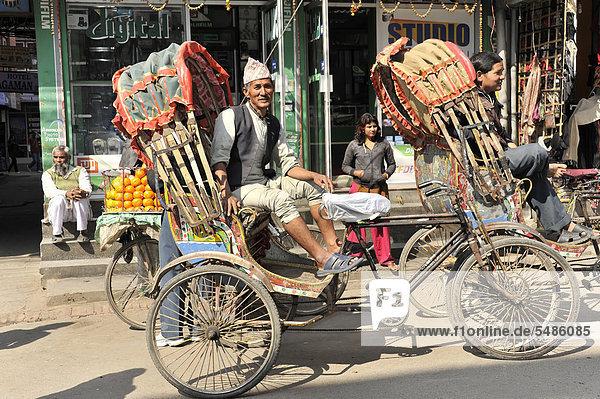 Rickshaw driver waiting for passengers  Kathmandu  Kathmandu Valley  Nepal  Asia