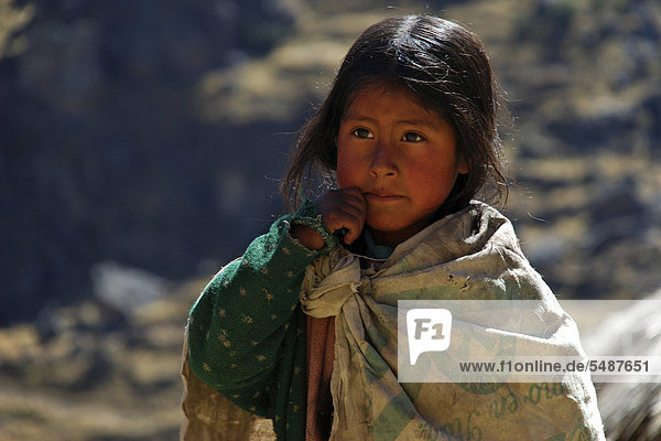 Poor girl of the indigenous peoples dressed in rags  portrait  near Cusco  Andes  Peru  South America