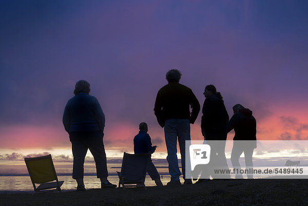 People on the beach watching the clouds at dusk  Atlantic Ocean  FinistËre  Brittany  France  Europe