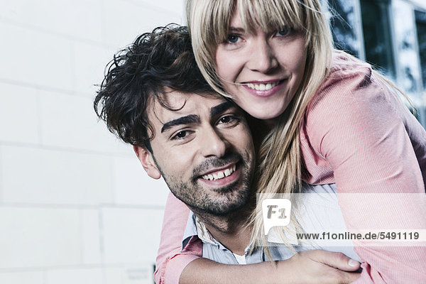 Germany  Cologne  Young couple smiling  portrait