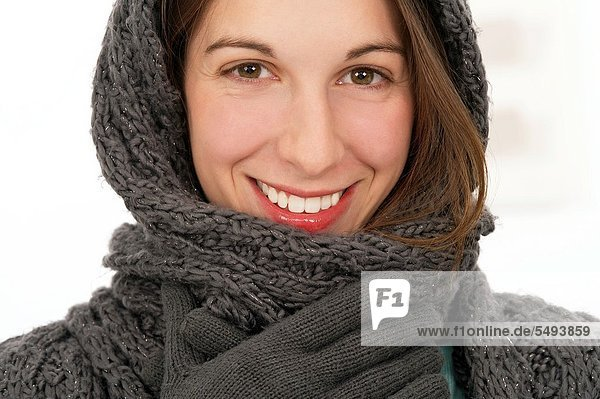 Young beautiful woman in woolen scarf  gloves and hat in winter