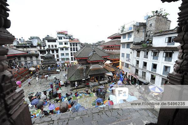 Royal Square  Durbar Square with market during rainy weather  Bagmati  Kathmandu  Nepal  South Asia  Asia