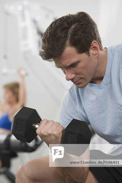 Man exercising with weight