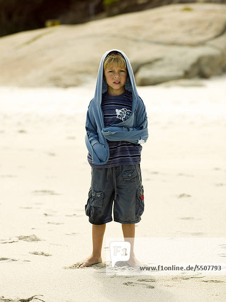 A young boy on the beach.