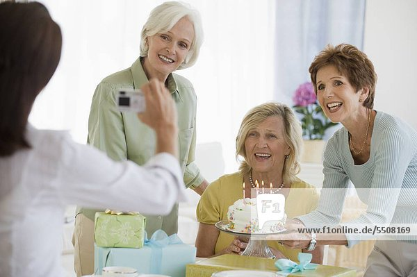 Senior women celebrating friendÌs birthday