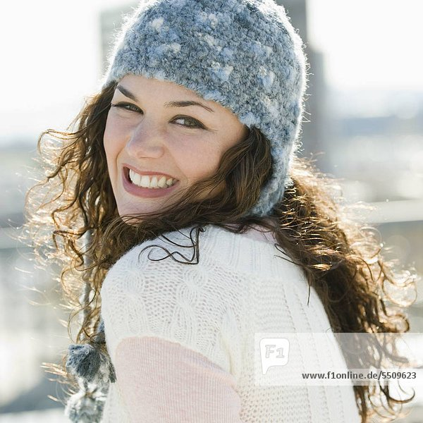 Portrait of woman smiling in stocking cap
