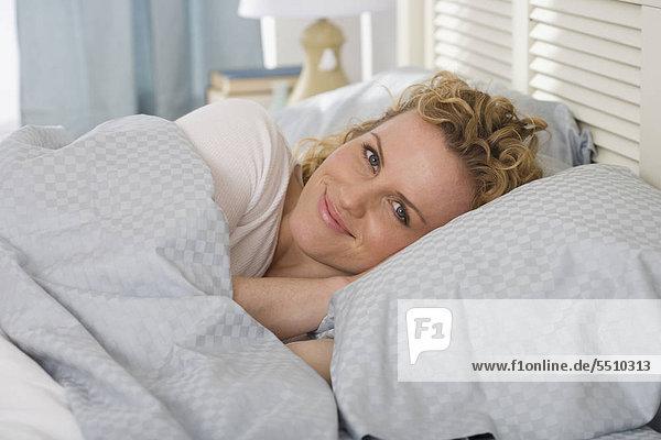 Portrait of Woman in Bett