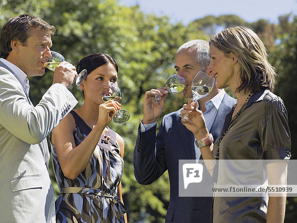 People drinking wine.