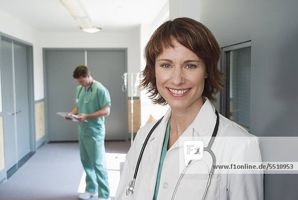 Female doctor leaning on wall