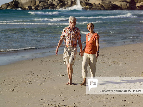A couple walking on the beach.