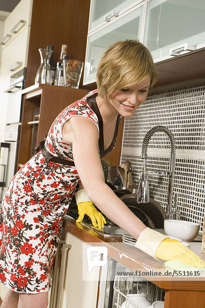 Woman washing dishes.