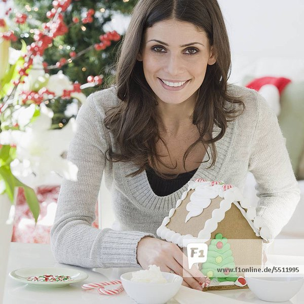 Woman making gingerbread house
