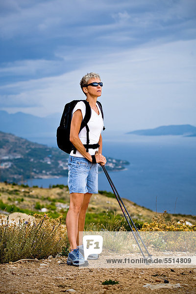 Woman hiking at the seaside  Omis  Adriatic coast  Croatia  Europe
