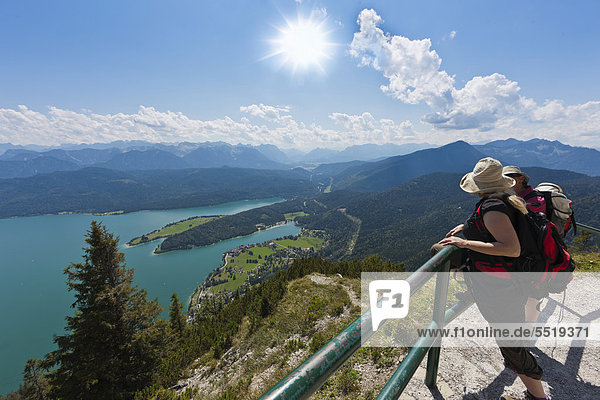 Hiker taking in the views from Mt Herzogstand across Walchensee Lake  district of Bad Toelz-Wolfratshausen  Upper Bavaria  Bavaria  Germany  Europe  PublicGround