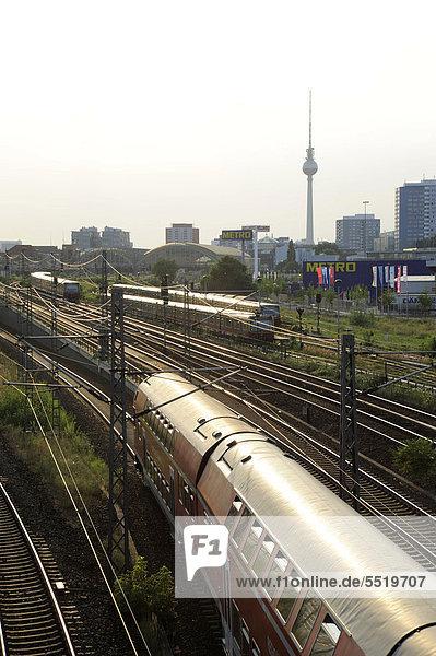 Train passing under the Warschau Bridge in Friedrichshain  the television tower at back  Berlin  Germany  Europe