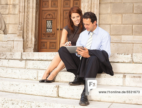 Business people working on stone steps
