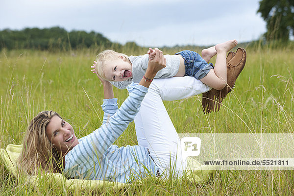 Mother and son playing in grass