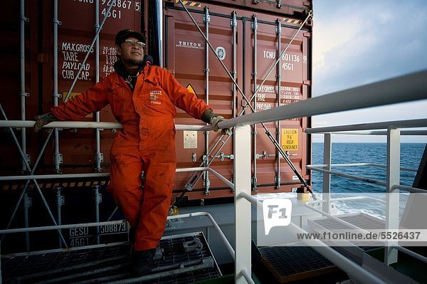 An Indonesian seaman or sailor on the container-vessel MV Flintercape  during a journey from Rotterdam  Netherlands  to Sundsvall  Sweden. The man is an ´Able Seaman´  who generally works on deck  and now enjoys the view over the Baltic Sea for a moment.