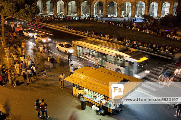 Traffic in front of the Colosseum at night  Rome  Italy  Europe
