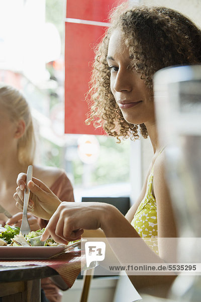 Young woman dining in restaurant