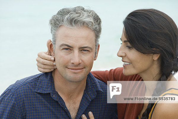 Woman looking affectionately at husband  portrait