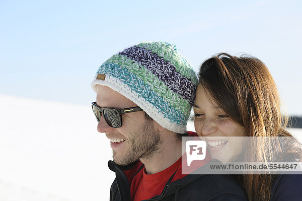 Young couple in the snow  Black Forest  Baden-Wuerttemberg  Germany  Europe  PublicGround