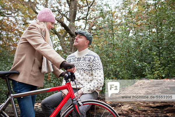 Couple in park with bike