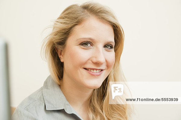 Smiling blond young woman  portrait