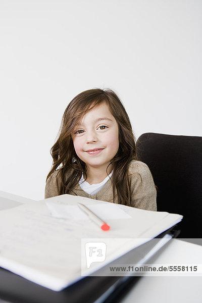 Girl doing her homework at desk