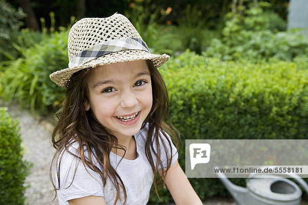 Girl smiling in backyard