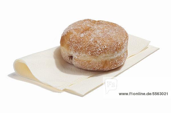 Ein Donut Marmelade auf einer Serviette