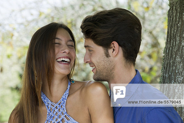 Young couple laughing  portrait