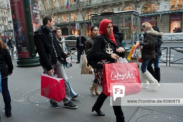 Paris  France  January Sales Shopping  Crowd Outside Galeries Lafayette Department Store  Walking on Sidewalk