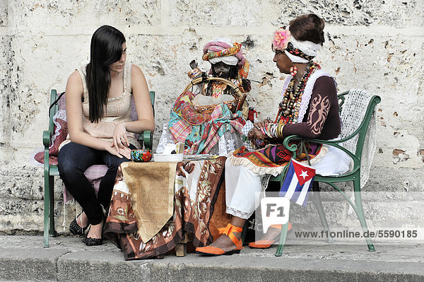 Fortune teller with a tourist  Plaza de la Catedral  Havana  Cuba  Greater Antilles  Caribbean  Central America  America