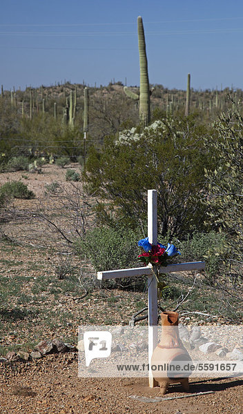 A shrine at the side of a road on the Tohono O'odham Reservation marks the site of a fatal auto accident  Sells  Arizona  USA
