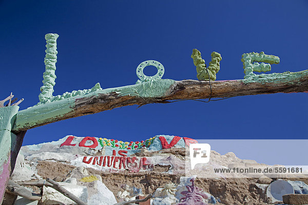 'Lettering ''love''  Salvation Mountain  a desert hillside covered with religious messages  created by Leonard Knight  Niland  California  USA'