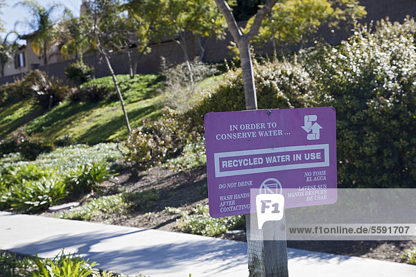 'A sign warns against drinking recycled water that is used for irrigation