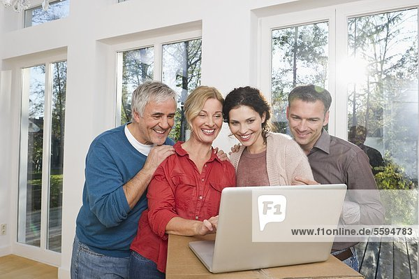 Man and woman using laptop  smiling
