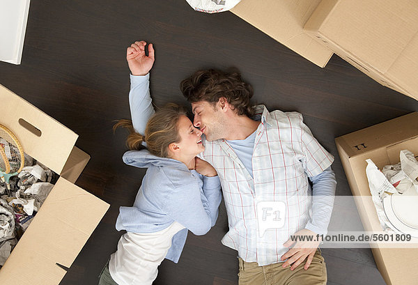 Couple laying together on floor
