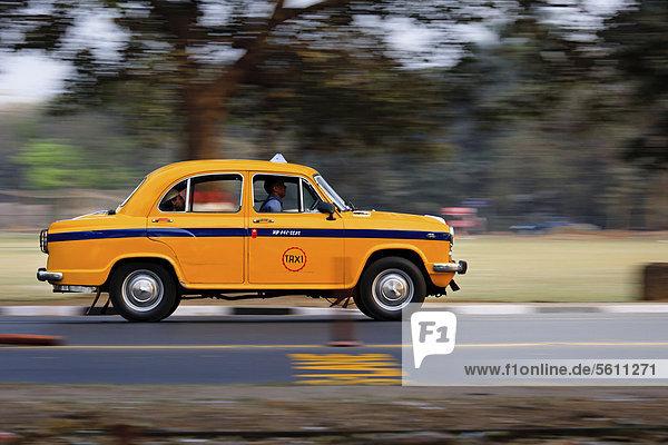 Indian taxi of the brand Ambassador speeding along a road in Kolkata  India  Asia