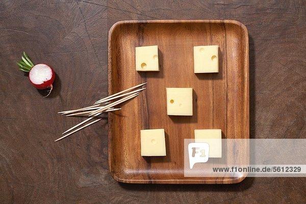 Cheeseboard  toothpicks and radish Cheeseboard, toothpicks and radish