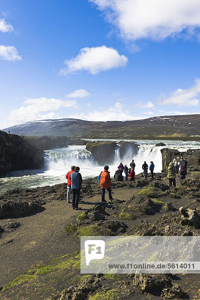 Tourists at Godafoss  waterfall of the gods  Iceland  Northern Europe  Europe