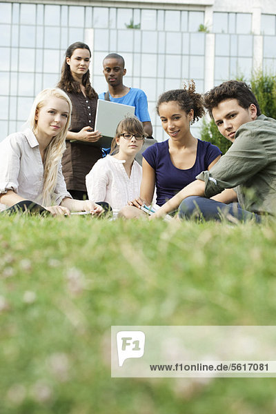 Young people hanging out on grass