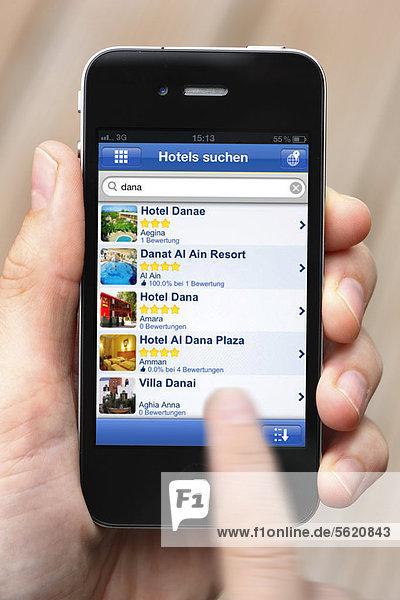 Iphone  Smartphone  App auf dem Display  Hotelbuchungs-Portal  Hotelbewertungen