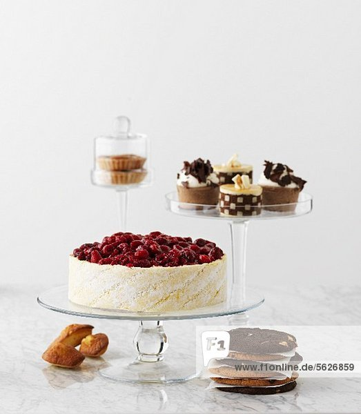 Raspberry cake  chocolate tart and cookies
