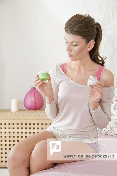Woman choosing facial cream