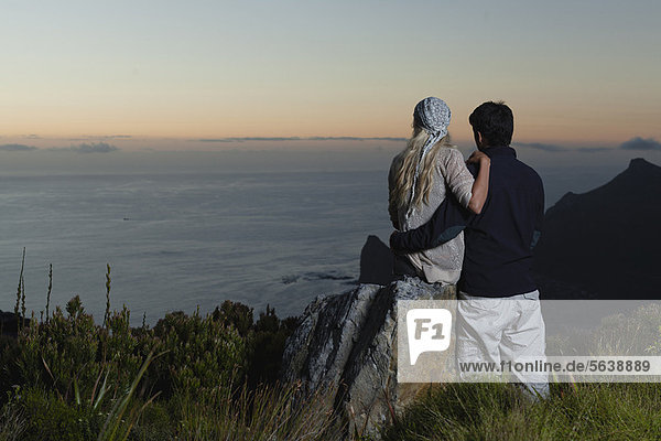 Couple overlooking coastal view